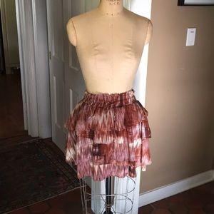All silk flouncy pull on mini skirt.